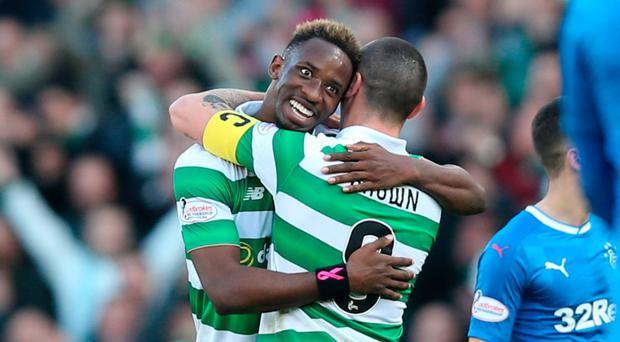 Well done: Scorer Moussa Dembele and Scott Brown