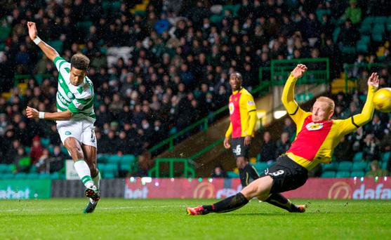 On target: Scott Sinclair sweeps home the only goal of the game as Celtic extended their Premiership lead to 14 points