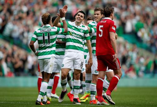 Popular Bhoy: Tom Rogic (centre) celebrates earlier this season