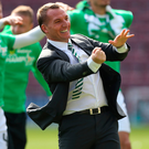 Champion spirit: Brendan Rodgers salutes the Celtic fans after yesterday's title-clinching victory over Hearts