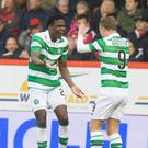 Dedryck Boyata (left) celebrates scoring his side's first goal of the game with teammate Leigh Griffiths