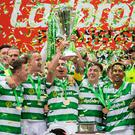 Unbroken: Skipper Scott Brown raises the Scottish Premiership trophy to kick-off Celtic's six-in-a-row celebration