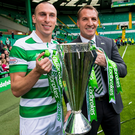 Cup for it: Scott Brown and Brendan Rodgers show off the Scottish Premiership trophy at Parkhead
