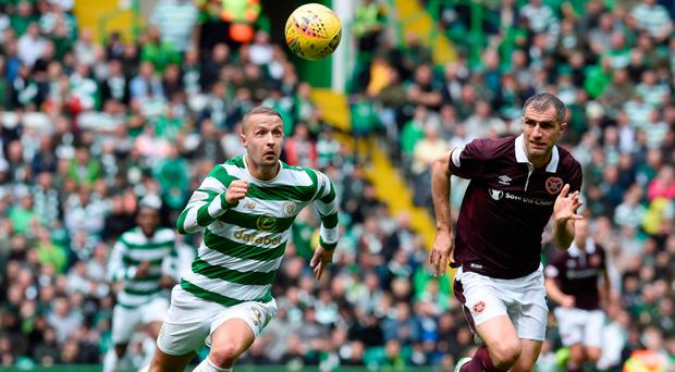 Heads I win: Leigh Griffiths is pursued by Hearts' Aaron Hughes