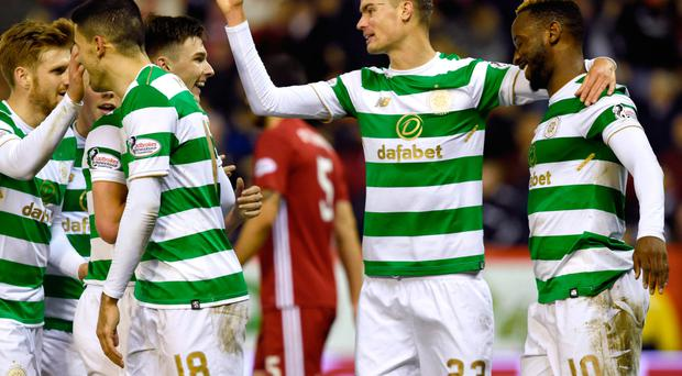 Happy Bhoys: Celtic's Moussa Dembele (right) celebrates scoring his side's second goal