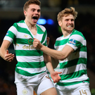 On course: James Forrest roars with delight alongside Stuart Armstrong after firing Celtic in front