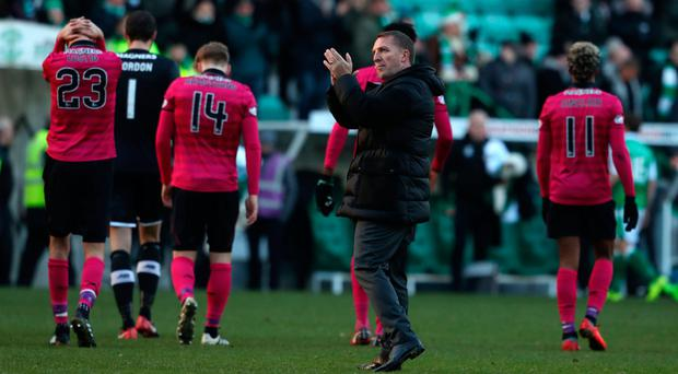 Close call: Rodgers applauds crowd after Hibs' late comeback against Celtic