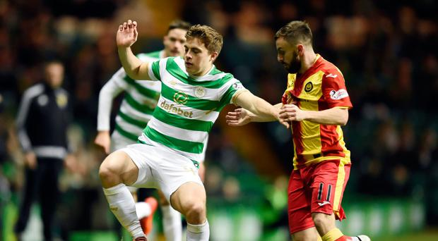 Battle: James Forrest protects possession from incoming Partick midfielder Steven Lawless