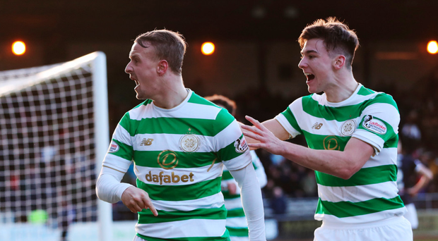 Easy street: Kieran Tierney celebrates with scorer Leigh Griffiths as Celtic go 2-0 ahead