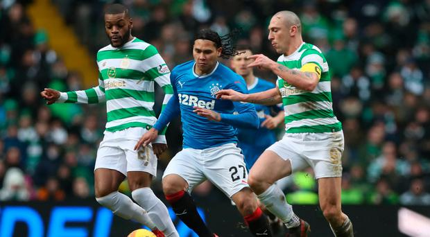 Tight game: Celtic captain Scott Brown up against of Carlos Pena of Rangers on Saturday