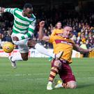 None shall pass: Ryan Bowman charges down a strike from Celtic's Moussa Dembele