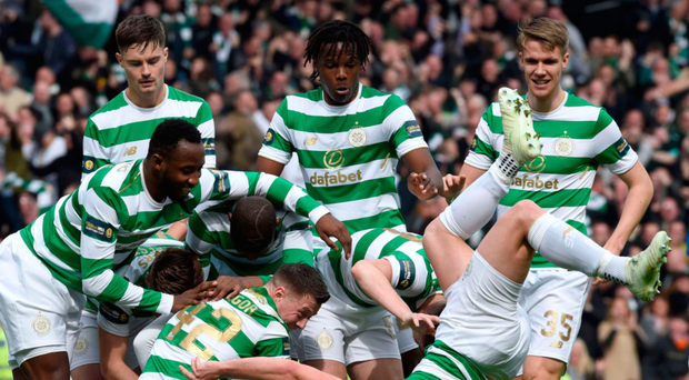 Fall guy: Celtic skipper Scott Brown gets a little bit carried away as his team mates celebrate Tom Rogic's opener