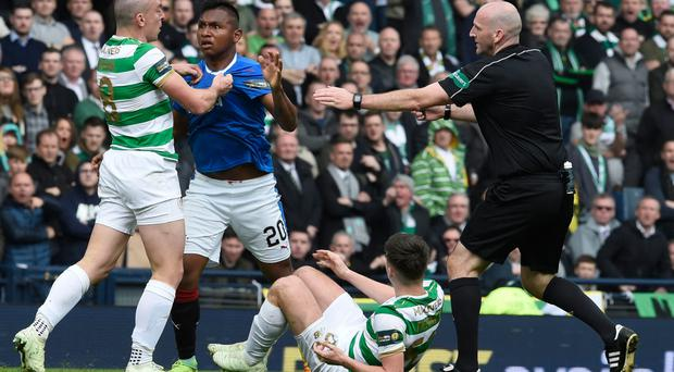 Heating up: Bobby Madden stops a confrontation between Scott Brown and Alfredo Morelos