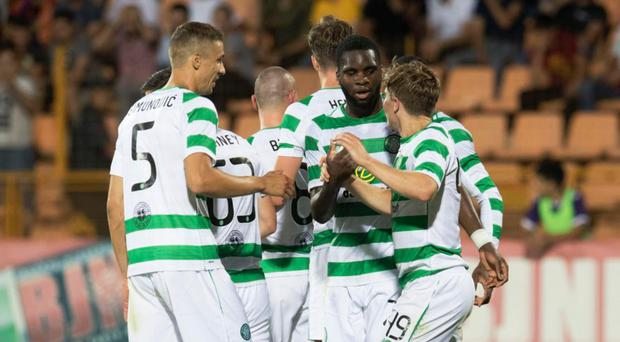 In command: Celtic celebrate James Forrest's goal