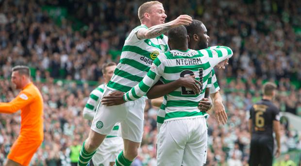 Up and running: Odsonne Edouard is mobbed after putting Celtic 2-0 up