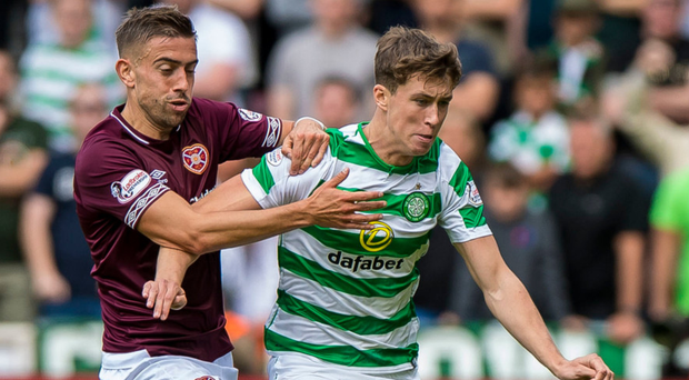 Hard battle: Celtic's Jack Hendry holds off Olly Lee of Hearts