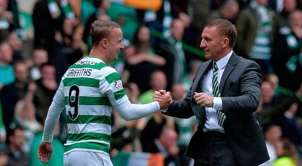 Winning feeling: Leigh Griffiths and Brendan Rodgers