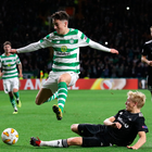 Up and away: Celtic's Michael Johnston is tackled by Birger Meling