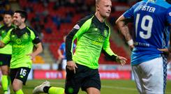 Breakthrough: Leigh Griffiths sets off in celebration after putting Celtic in front
