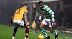 Duel: Olivier Ntcham takes on Motherwell's Richard Tait