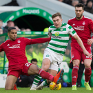 No way through: Celtic's James Forrest is stopped by Aberdeen's Max Lowe