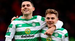 Happy Bhoys: Tom Rogic and James Forrest celebrate yesterday's victory