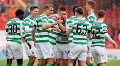 Oh Bhoy: Michael Lustig (centre) is congratulated by team-mates after scoring the opening goal for Celtic