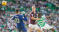 Final touch: Vakoun Bayo and Christophe Berra look on as the ball sails in for Celtic's opening goal
