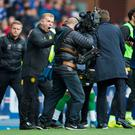 Picture perfect: Neil Lennon celebrates for the cameras