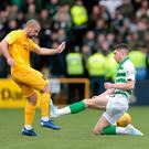 Horror tackle: Celtic ace Ryan Christie saw a straight red card after this lunge on Livingston's Scott Robinson