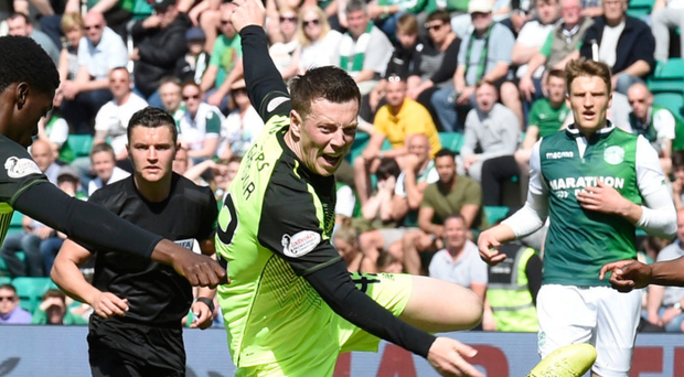 Fall guy: Celtic ace Callum McGregor is brought down by Hibernian's Lewis Stevenson