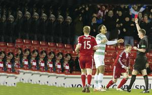 Off night: Virgil van Dijk is shown a red card to begin Celtic's agony in their defeat to Aberdeen
