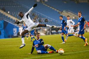 Air time: Rangers midfielder Glen Kamara (top) jumps as he vies for the ball with Lech Poznan defender Lubomir Satka