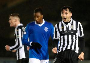 Knockout blow: St Mirren's Conor McCarthy (right) celebrates dumping Rangers out of the Scottish League Cup