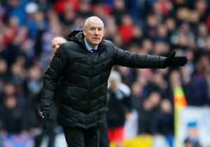 Showing the way: Mark Warburton wants the Rangers defence to tighten up after conceding nine goals in three games