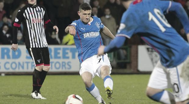 Rangers' Fraser Aird opens the scoring last night