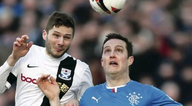 Head man: Jon Daly battles Ayr's Gordon Pope in Gers win