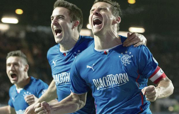 Champion feeling: Lee McCulloch (far right) and Andrew Little celebrate