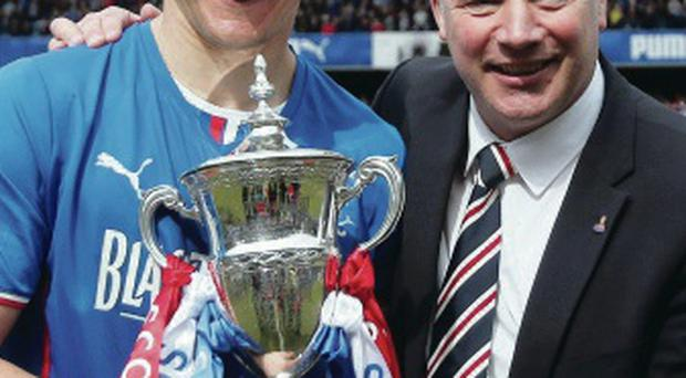 Lee McCulloch and Ally McCoist with the title