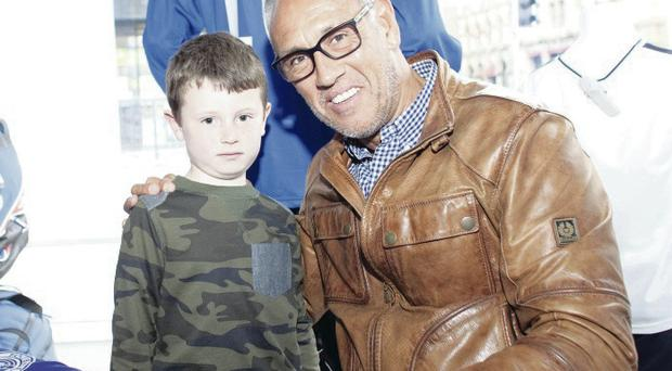 Heroes welcome: Six-year-old Cooper McCoist Masion meets Rangers legend Mark Hateley at the Rangers shop in Belfast