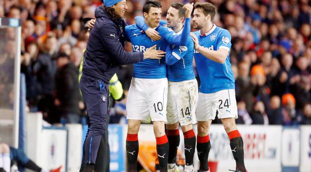 In the net: Haris Vuckic (second left) is congratulated after opening the scoring for Rangers