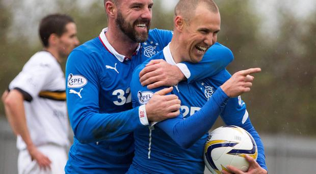 Keeping the faith: Kenny Miller (right) believes Rangers will win promotion this season