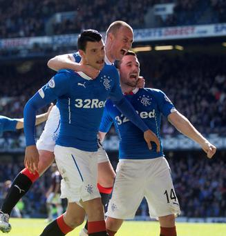 Victory dance: Haris Vuckic (left) celebrates with Kenny Miller and Nicky Clark after scoring Rangers' second goal at Ibrox