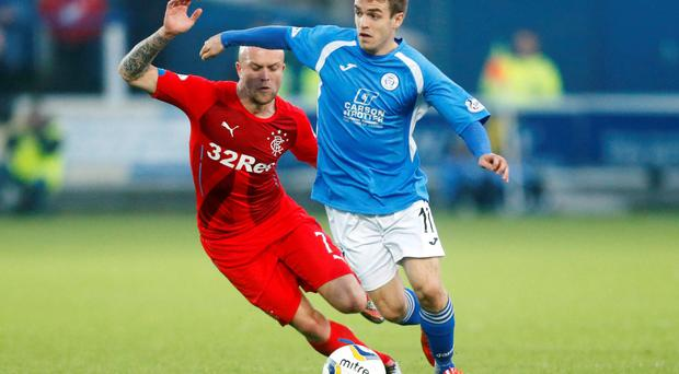 Chasing down: Rangers' Nicky Law pursues Queen of the South's Iain Russell at Palmerston but to no avail