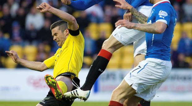 Man marked: Livingston's Jason Talbot (left) stops Rangers ace Haris Vukic (centre)