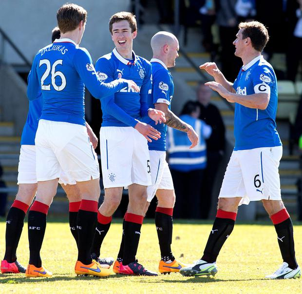 Double delight: Ryan Hardie is congratulated after hitting a brace against Dumbarton on his full debut for the club
