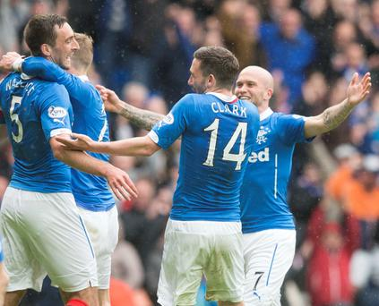 Goal-den boy: Rangers Lee Wallace (left) celebrates his vital goal during the Scottish Premiership play off clash at Ibrox