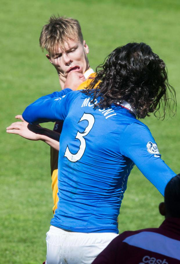 Hitting out: Bilel Mohsni strikes Motherwell's Lee Erwin