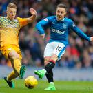 Footing it: Jamie Lindsay and Barrie McKay do battle
