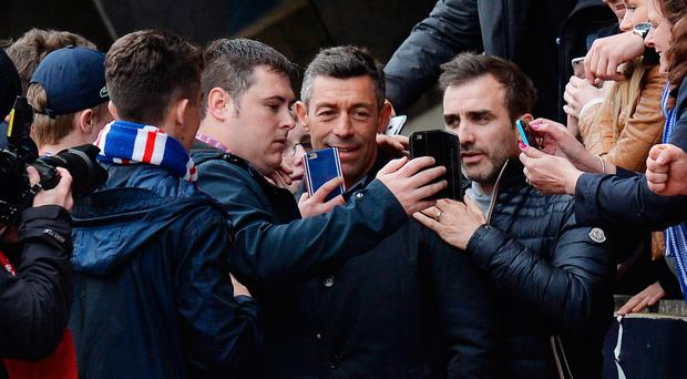 In the picture: Boss Pedro Caixinha celebrates with Gers fans